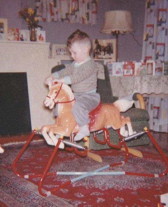 Bruce Martin riding spring horse as a boy